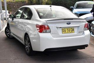2015 Subaru Impreza G4 MY15 2.0i AWD Premium White 6 Speed Manual Sedan.