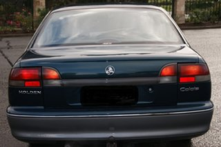1995 Holden Calais VS Flame Blue/Silver 4 Speed Automatic Sedan.