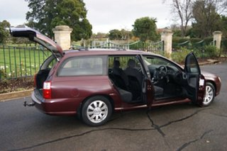 2003 Holden Berlina VY Burgundy 4 Speed Automatic Wagon.