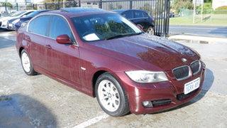 2009 BMW 3 Series E90 MY09 323i Steptronic Red 6 Speed Sports Automatic Sedan.