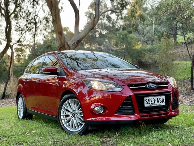 Used Ford Focus LW Sport Reynella, 2012 Ford Focus LW Sport Candy Red 5 Speed Manual Hatchback