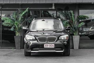 2010 BMW X1 E84 MY11 xDrive23d Steptronic Black 6 Speed Sports Automatic Wagon.