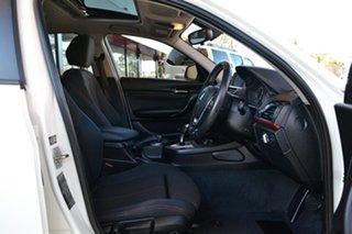 2012 BMW 1 Series F20 116i White 8 Speed Sports Automatic Hatchback.