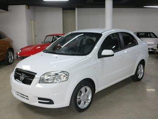 2011 Holden Barina TK MY11 White 5 Speed Manual Sedan.