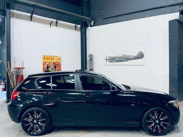 Used BMW 1 Series F20 MY0713 118i Steptronic Port Melbourne, 2014 BMW 1 Series F20 MY0713 118i Steptronic Black 8 Speed Sports Automatic Hatchback