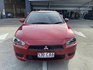 2013 Mitsubishi Lancer CJ MY14 ES Red 5 Speed Manual Sedan.