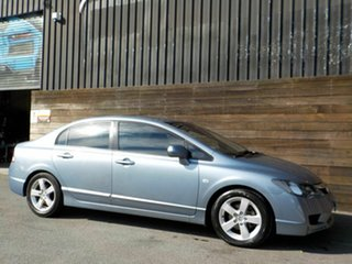 2009 Honda Civic 8th Gen MY09 VTi-L Blue 5 Speed Manual Sedan.