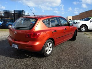 2004 Mazda 3 BK Neo Orange 5 Speed Manual Hatchback.