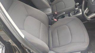 2012 Kia Rio UB MY12 SLi Black 6 Speed Manual Hatchback