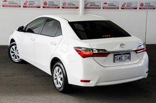 Toyota Corolla Glacier White Sedan.