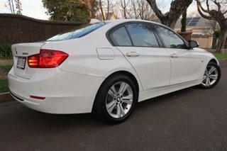 2013 BMW 3 Series F30 MY0813 320i White 8 Speed Sports Automatic Sedan.
