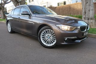2012 BMW 320i F30 320i Bronze 8 Speed Sports Automatic Sedan.