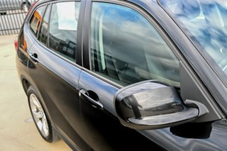 2012 BMW X1 E84 MY0312 sDrive20d Steptronic Black 6 Speed Sports Automatic Wagon.