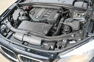 2012 BMW X1 E84 MY0312 sDrive20d Steptronic Black 6 Speed Sports Automatic Wagon