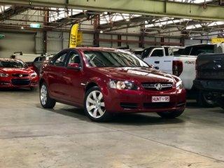 2007 Holden Commodore VE Lumina Red 4 Speed Automatic Sedan.