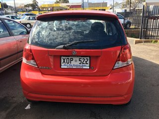2007 Holden Barina TK MY07 Red 5 Speed Manual Hatchback.