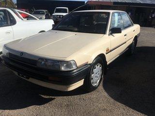 1990 Holden Apollo JK Executive Beige 4 Speed Automatic Sedan.