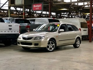 2003 Mazda 323 BJ II-J48 Astina Shades Gold 4 Speed Automatic Hatchback.