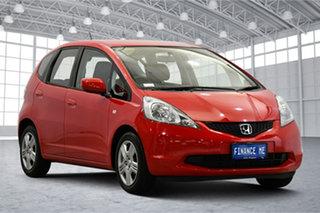 2010 Honda Jazz GE MY10 VTi Red 5 Speed Automatic Hatchback.