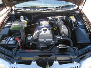 1999 Ford Falcon AU Red 4 Speed Automatic Sedan