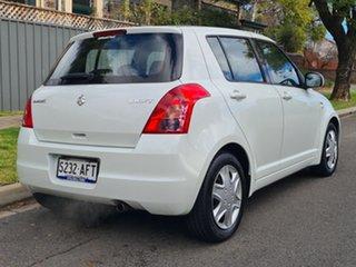 2009 Suzuki Swift RS415 White 4 Speed Automatic Hatchback.