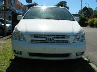 2008 Kia Carnival VQ EX White 5 Speed Automatic Wagon.