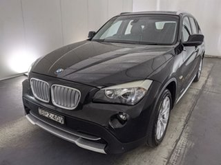 2010 BMW X1 E84 xDrive23d Steptronic Black 6 Speed Sports Automatic Wagon.