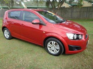 2012 Holden Barina TK MY11 Red 5 Speed Manual Hatchback.