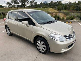 2010 Nissan Tiida C11 S3 ST Gold 4 Speed Automatic Hatchback.