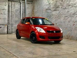 2013 Suzuki Swift FZ GL Orange 4 Speed Automatic Hatchback.