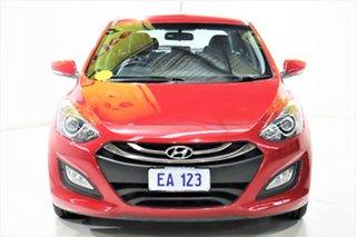 2014 Hyundai i30 GD2 MY14 Trophy Red 6 Speed Manual Hatchback.