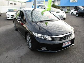 2012 Honda Civic Sport Black 4 Speed Automatic Sedan.