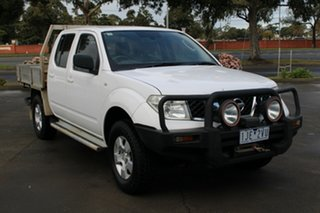 2010 Nissan Navara D40 RX (4x4) White 6 Speed Manual Dual Cab Pick-up.