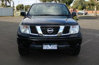 2011 Nissan Navara D40 ST (4x4) Black 5 Speed Automatic Dual Cab Pick-up.