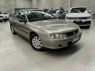 2001 Holden Commodore VX II Executive White 4 Speed Automatic Sedan.