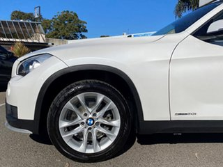 2014 BMW X1 E84 MY14 Upgrade sDrive 20I Mineral White 8 Speed Automatic Wagon.