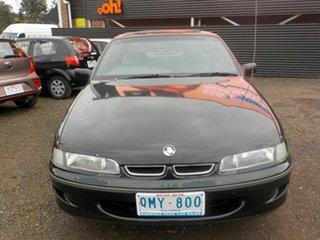 1996 Holden Commodore VSII Acclaim Black 4 Speed Automatic Sedan.