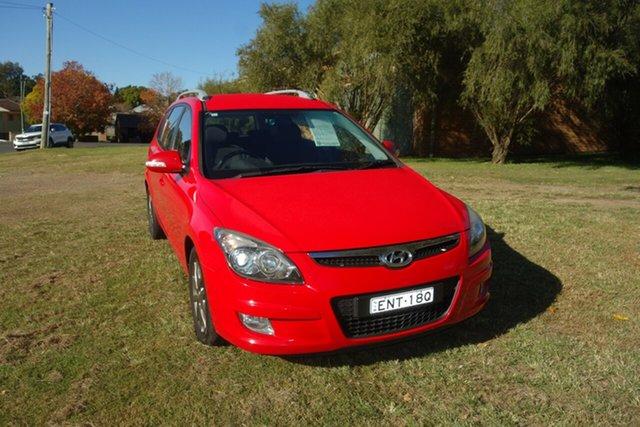 Used Hyundai i30 FD MY11 SLX cw Wagon East Maitland, 2011 Hyundai i30 FD MY11 SLX cw Wagon Red 4 Speed Automatic Wagon