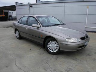 1999 Holden Commodore VT Acclaim Fawn 4 Speed Automatic Sedan.