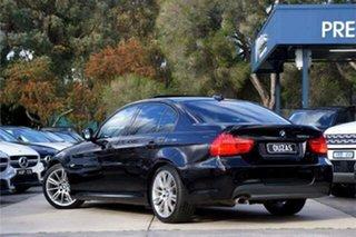 2009 BMW 3 Series E90 MY10 320d Steptronic Executive Black 6 Speed Sports Automatic Sedan.
