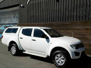 2013 Mitsubishi Triton MN MY13 GLX Double Cab White 4 Speed Sports Automatic Utility.
