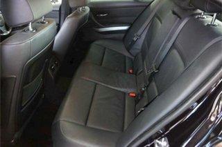 2009 BMW 3 Series E90 MY10 320d Steptronic Executive Black 6 Speed Sports Automatic Sedan