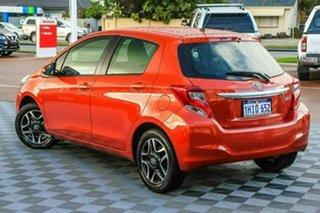 2015 Toyota Yaris NCP130R Ascent Orange 4 Speed Automatic Hatchback.