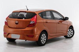 2015 Hyundai Accent RB2 MY15 Active Orange 4 Speed Sports Automatic Hatchback.