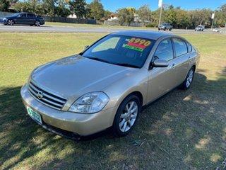2004 Nissan Maxima J31 TI Gold & Black 4 Speed Automatic Sedan.