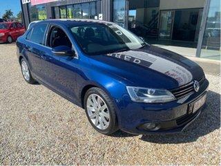 2013 Volkswagen Jetta 1KM MY13 118 TSI Blue 7 Speed Auto Direct Shift Sedan.