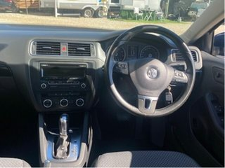 2013 Volkswagen Jetta 1KM MY13 118 TSI Blue 7 Speed Auto Direct Shift Sedan