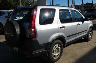 2005 Honda CR-V 2005 Upgrade (4x4) Silver 5 Speed Automatic Wagon.