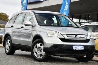 2009 Honda CR-V RE MY2007 4WD Silver 6 Speed Manual Wagon.