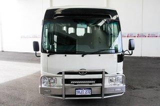 Toyota Coaster French Vanilla Bus.